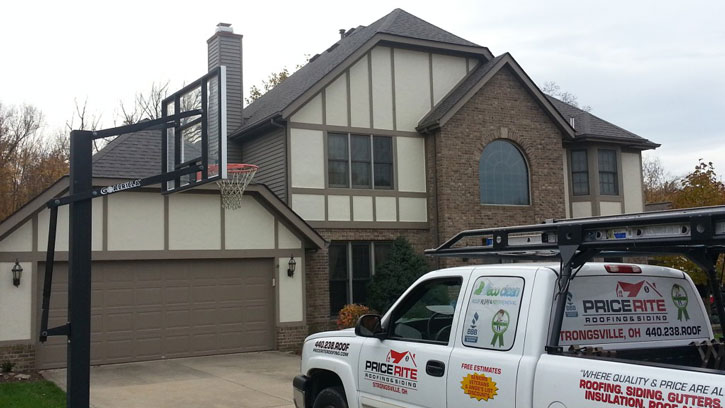 Roofing Contractors - Picture of Doug Coyne pulling up to a client's house in company truck.