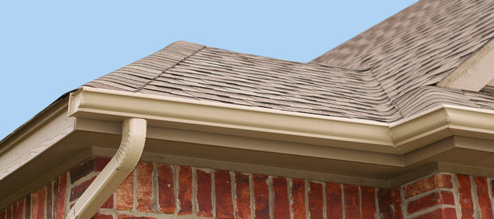 Seamless Gutters - Picture of a roof with new gutters.