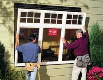 replacement windows - Picture of two men installing a new window